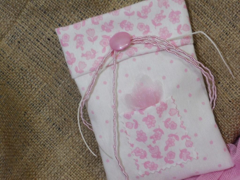 mpomponiera vaptisis portofolaki roz